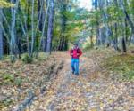 a guy hiking during fall