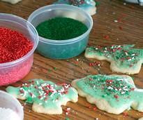 christmas cookies being decorated