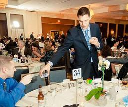 steven brundage performing magic at an event