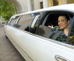 bride in limo arriving at wedding reception