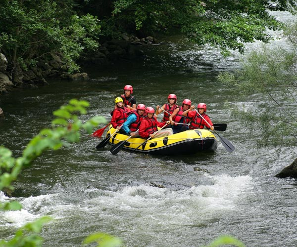 group of people in a whitewater raft