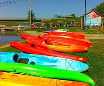 colorful kayaks on the ground
