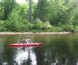 person in a red kayak