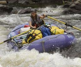 one person in a raft on a river