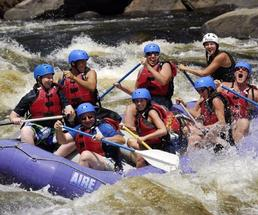 whitewater rafting trip and paddlers