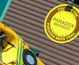 Paradox Brewery sign with yellow kayak
