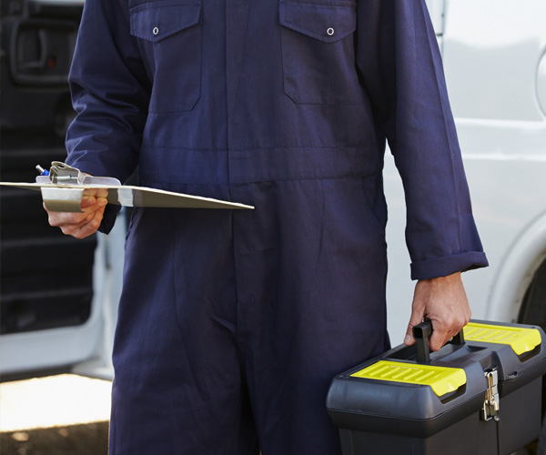 inspector with clipboard and toolbox