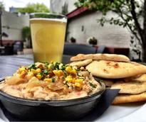 creamy dip with beer on a patio