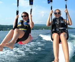 girls parasailing over lake george