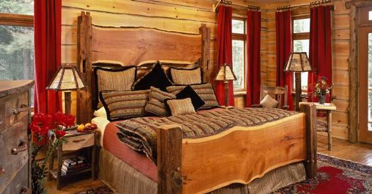 inside Adirondack cabin bedroom with fall colors