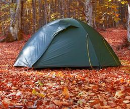 tent by the lake in fall