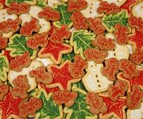 holiday cookies that are red and green and in different shapes