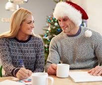 couple writing christmas list