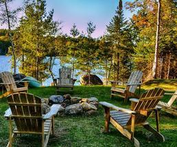 Adirondack chairs around fire pit, fall
