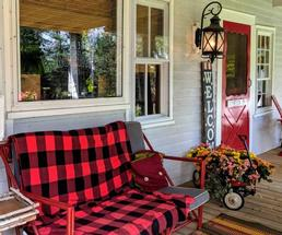 bench in front of B&B with buffalo plaid