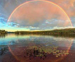 rainbow reflection on lake