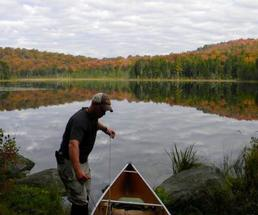man with canoe in the fall