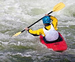 person whitewater kayaking