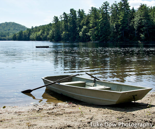 rowboat on the shore of a lake
