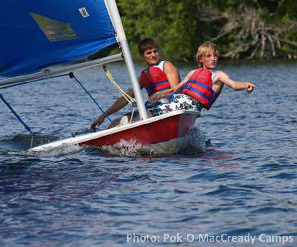 boys on a sailboat at camp