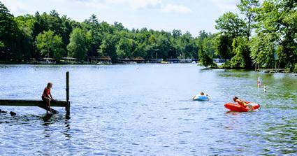 dock and kayaks at an island camping spot