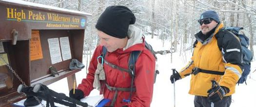 people signing in at trailhead in winter