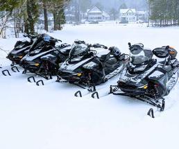 snowmobiles in a row
