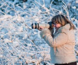 woman taking pictures in the winter