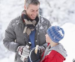 father and son outside in winter