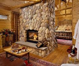 room in cabin with fire, champagne, etc.