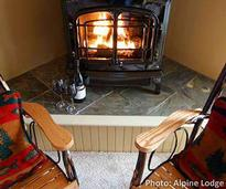 chairs by a fireplace