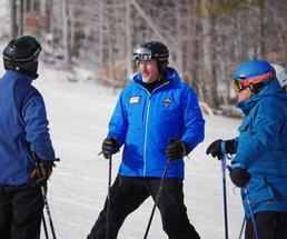 skiers dressed in blue
