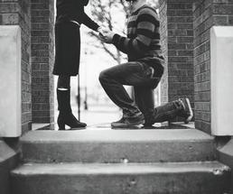 black and white image of guy proposing