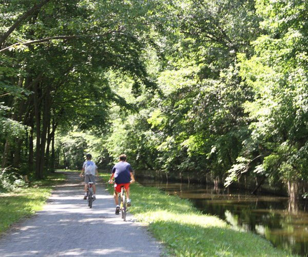two boys biking along the feeder canal