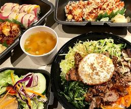 japanese food in takeout containers