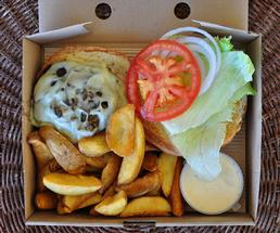 to go box with a burger and fries