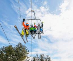 people on ski lift