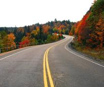 road with fall foliage in the Adirondacks
