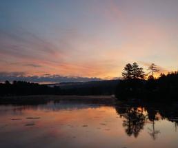 Blue and orange sunrise over a lake