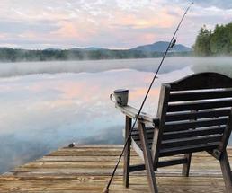 chair on dock overlooking sunrise