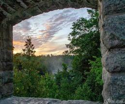 Sunrise through window in a stone bridge