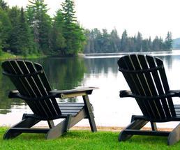 adirondack chairs on a lake