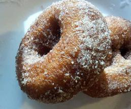 Apple cider donuts covered in granulated sugar