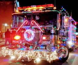 fire truck lit up with Christmas lights