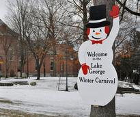 Wooden snowman welcome sign for the Lake George Winter Carnival