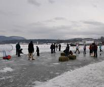 people on ice playing hockey