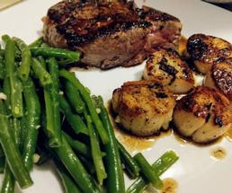 steak, green beans, and scallops
