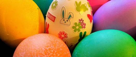Easter eggs and one with stickers including a bunny