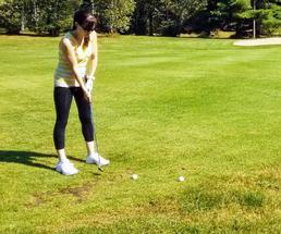 woman golfs