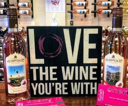 sign that says Love the Wine You're With with wine